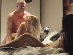 Amazing threesome action with two luscious women on the bed