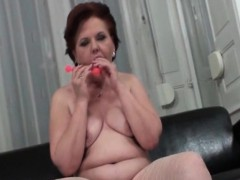 Mature pleasing pussy with toys in close-up