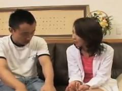Horny Asian MILF sucks and fucks a younger stud's stiff pri