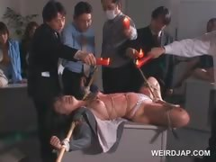 Tied up asian slave gets wax dripped on her sexy body
