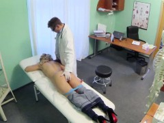 Blonde babe gets fingered and sucks her doctors cock