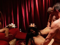 Sexy swingers sucking and fucking in the red room