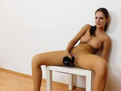 Jennifer Amton covered in nylons while she rides a black