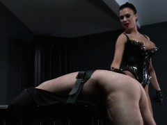 Busty mistress whips strapped sub