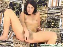 Innocent cute Juli shows off her shaved pussy