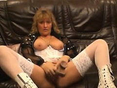Busty mature demonstrates her dildo driving abilities about