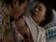 Luscious Japanese wife with big boobs has her man drilling