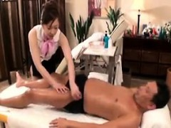 Sensuous Oriental masseuse with big boobs knows her way aro