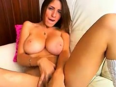 Busty brunette babe with hot big boobs masturbating her puss