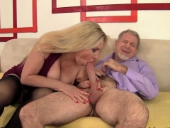 Mature Blonde Woman And A Guy Kiss With Each Other She